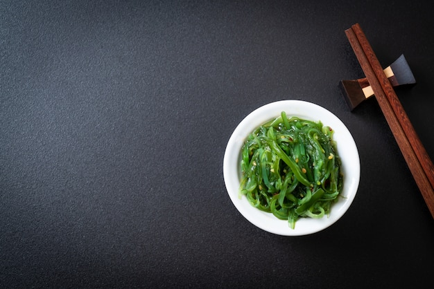 Seaweed salad - japanese style black background with copyspace