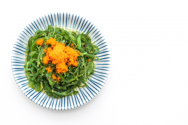 Seaweed salad with shrimp eggs isolated