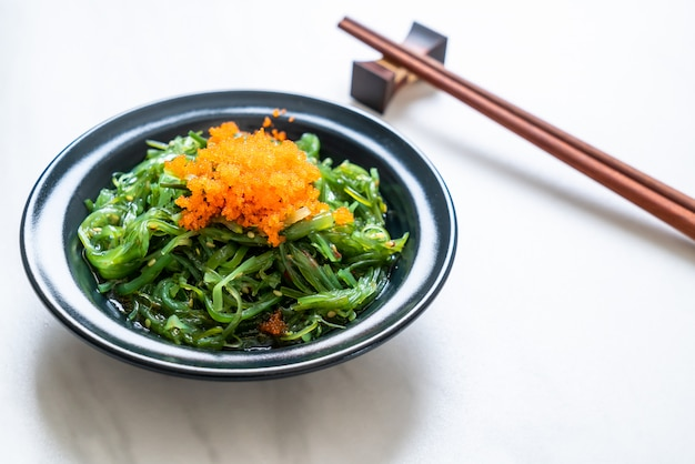 Seaweed salad with shrimp eggs  in japanese style