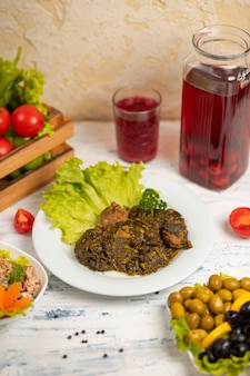 Sebzi qovurma, meat with vegetables served with lettuce, salad.