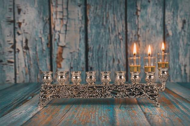 Second dayof hanukkah with burning hanukkah candles hanukkiah traditional candelabra