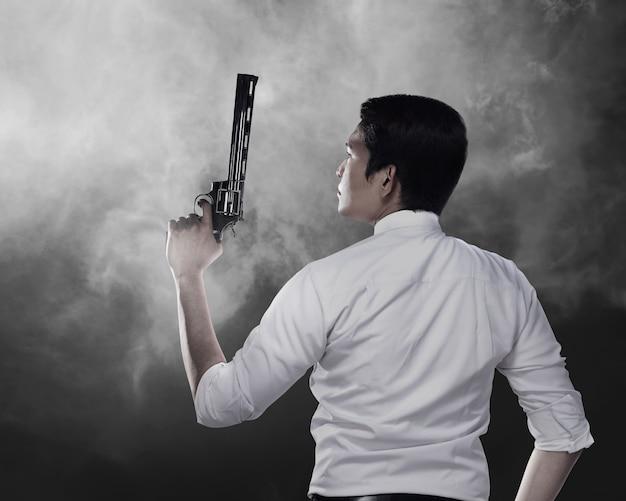 Secret agent holding gun
