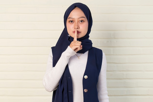Secret young asian muslim woman in hijab