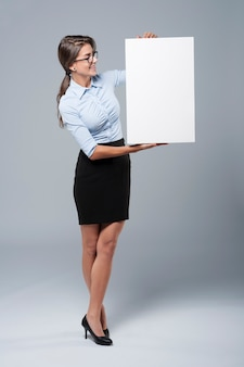 Secretary holding an empty vertical placard