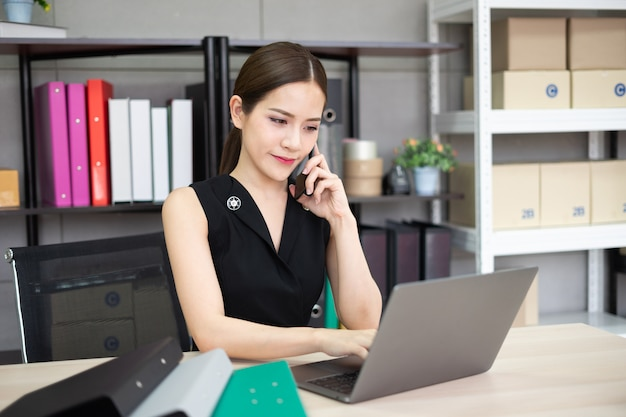 A secretary is calling to her customer