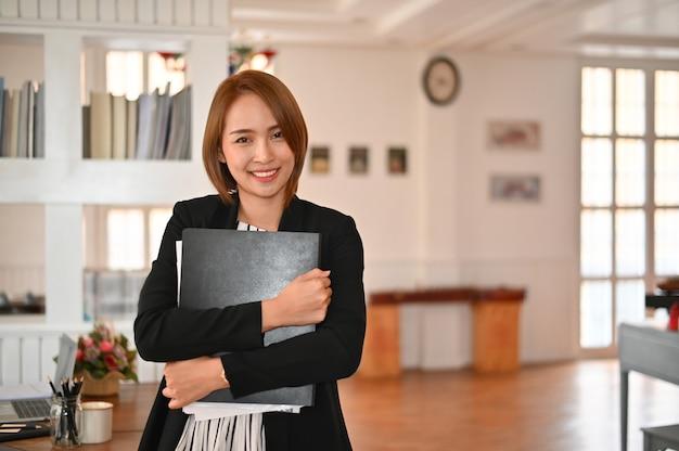 Secretary woman posting on office workplace.