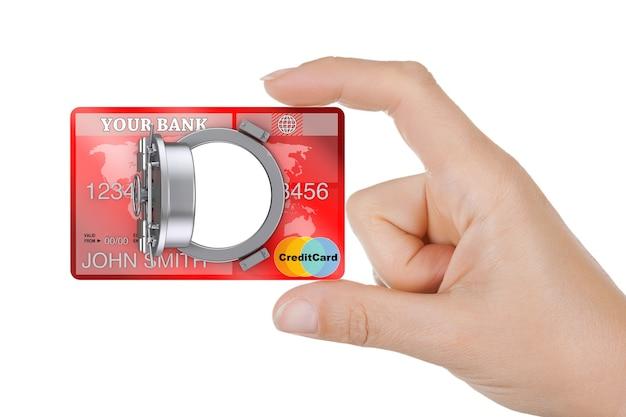 보안 온라인 뱅킹 개념입니다. 근접 촬영 여자 손 흰색 바탕에 은행 안전 문이 있는 신용 카드를 잡아.