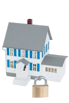 Secured grey house against a white background