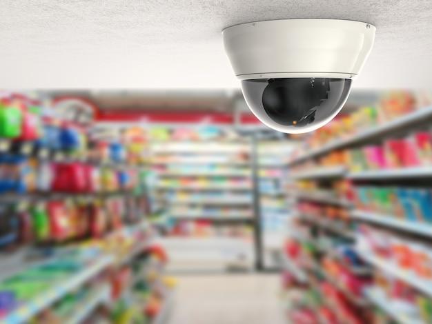 Камера видеонаблюдения или камера видеонаблюдения на потолке с фоном розничного магазина