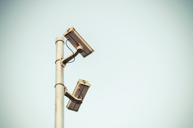 Security camera of two cctv video surveillance take with vintage color