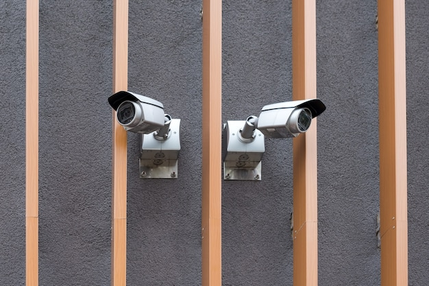 Security cameras on modern building professional surveillance camera cctv on the wall