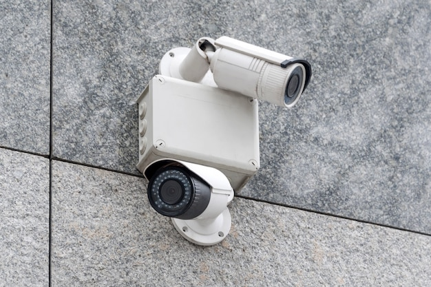 Security cameras on modern building