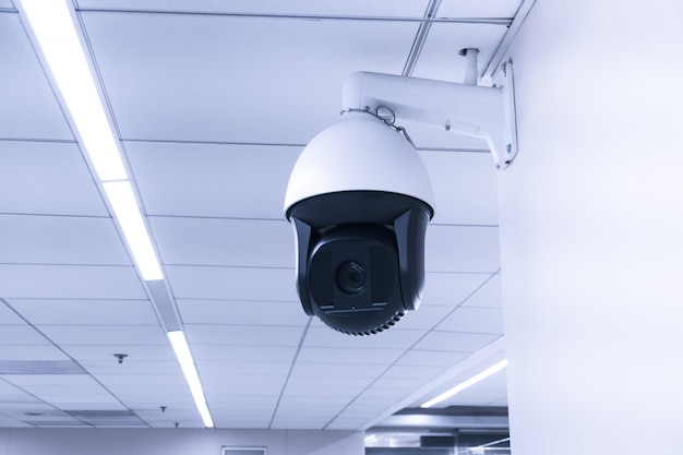 Security cctv camera or surveillance system in building. closed-circuit television. modern cctv camera on a wall.