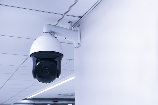 Security cctv camera or surveillance system in building ,closed-circuit television,modern cctv camera on a wall.