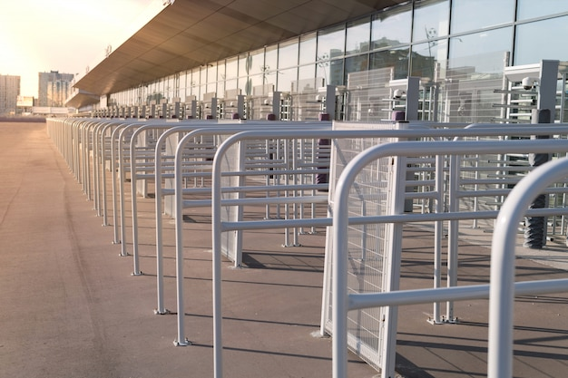 Security entrance gate - secured turnstiles before inspection at stadium