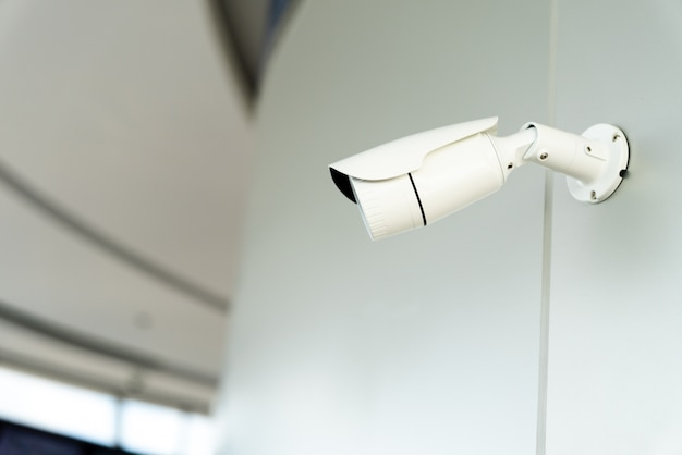 Security white cctv (closed-circuit television) camera in the office building