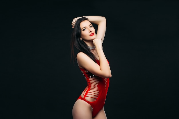 Seductive woman with make up in red torn body costume