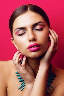 Seductive woman with sexy big pink lips and closed eyes
