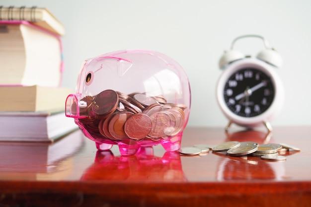 A see through piggy bank with money coins