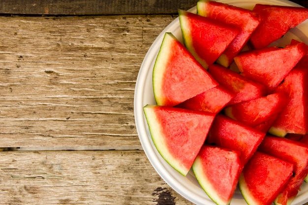 Seedless watermelon cut into wedges serving on dish