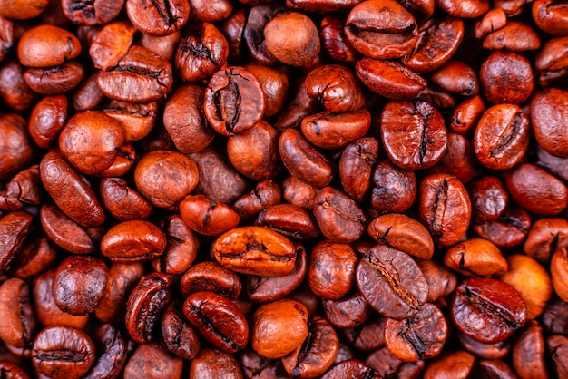 Seeds of fragrant coffee on a dark concrete background. it can be used as a background