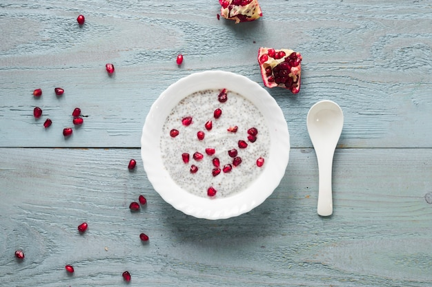 Seeds of pomegranate on chia seed pudding in bowl for morning breakfast