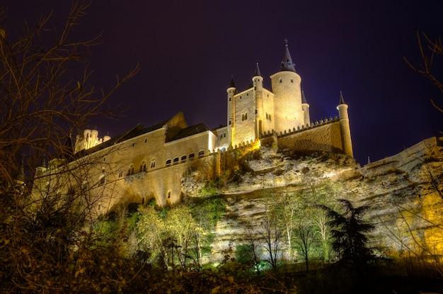 Segovia alcazar castle at night. ancient royal palace in segovia spain.