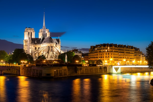 Seine river and notre dame de paris at night in paris, france.