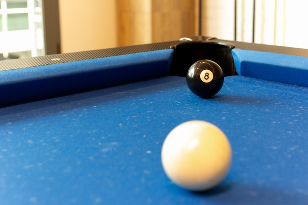Selected focus on ball n. 8 on billard table.