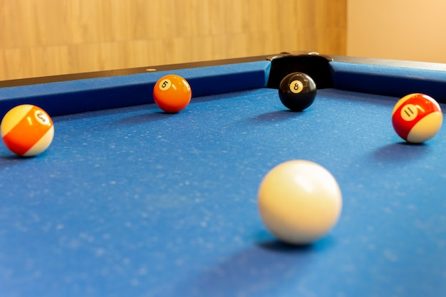 Selected focus on ball n. 8 on billiard table.