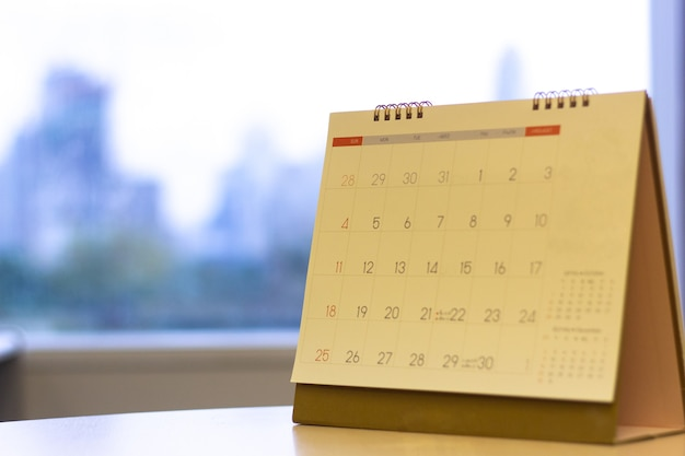 Selected focus calendar on the  table with city view background