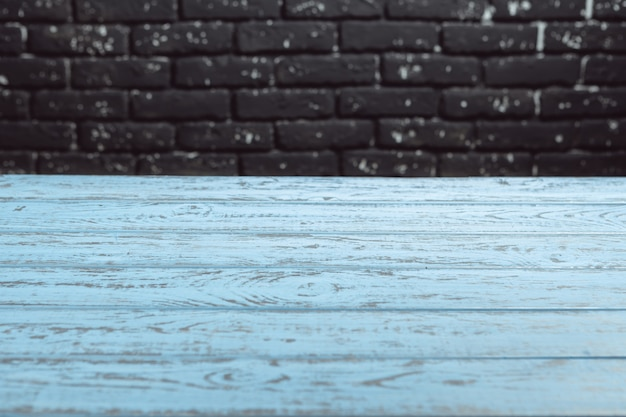 Selected focus empty wooden table background and wall texture or old brick wall