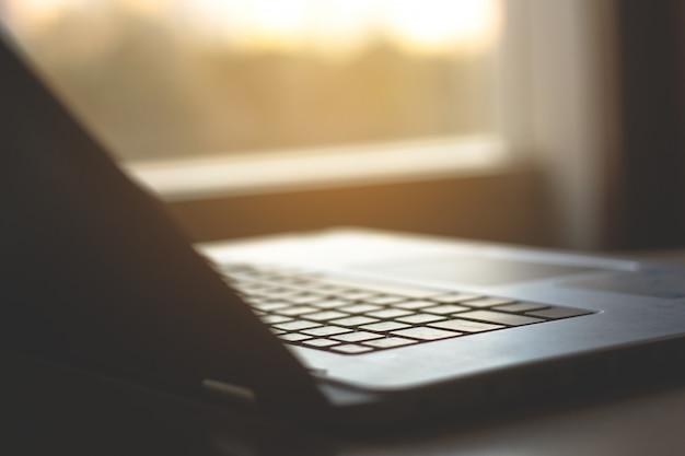Selected focus  keyboard  laptop with dark tone.