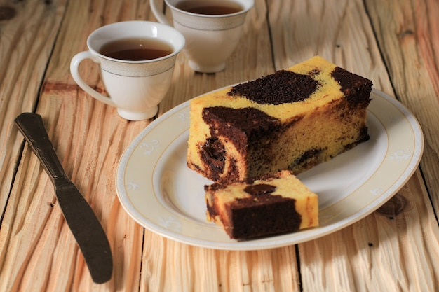 Selected focus marble travel cake, mini loaf marble cake with melted chocolate inside. also known as tube cake. served on cream plate