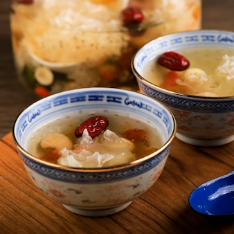 Selected focus peach gum triple collagen dessert, chinese traditional refreshment beverages contains peach gum, bird nest, red dates, snow fungus, goji berry, pandan leaves, and rock sugar.