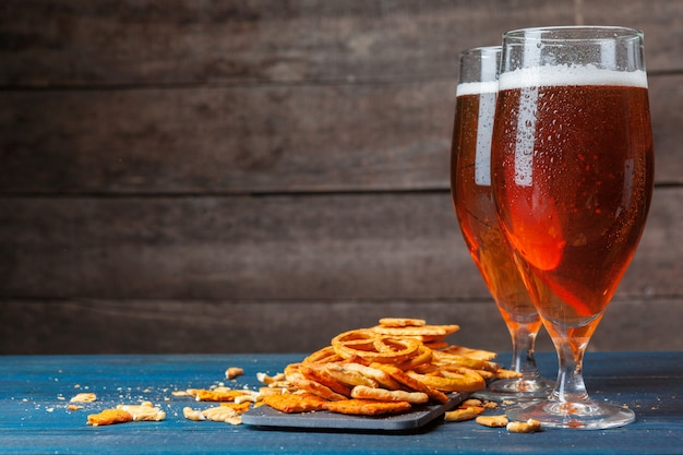 A selection of beer and snacks on wooden