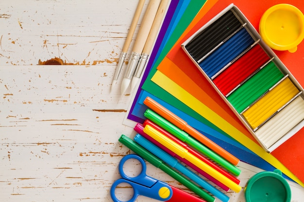 Selection of child stationery on white wood