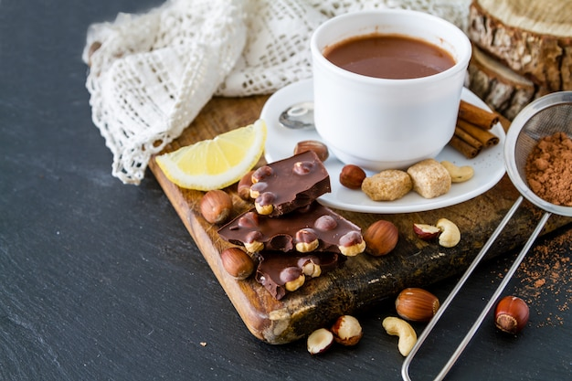 Selection of chocolate and nuts, copy space