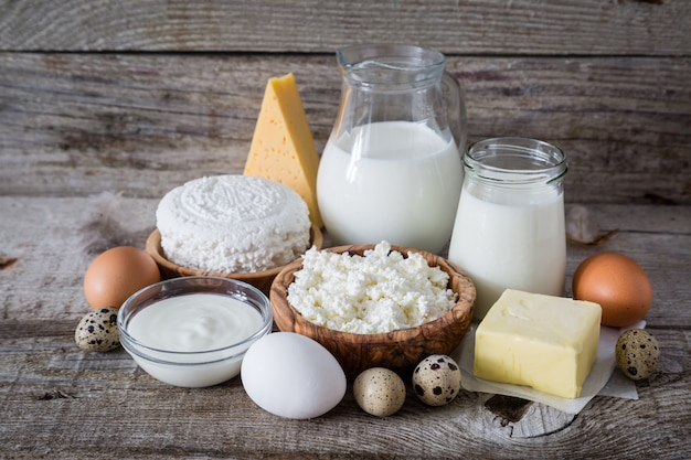 Selection of dairy products on rustic wood background