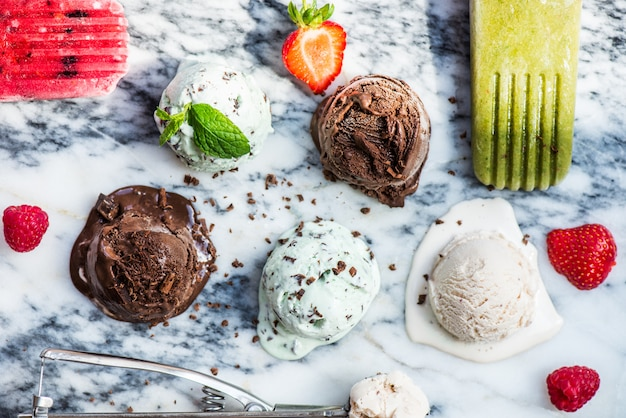 Selection of different ice cream scoops such as mint, chocolate and strawberry
