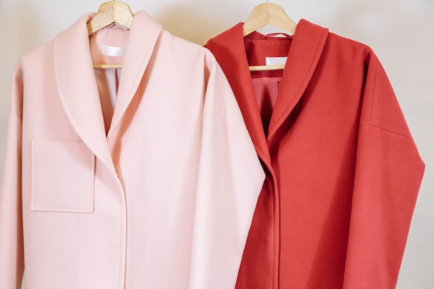 The selection of fashionable coats on hangers in the store.
