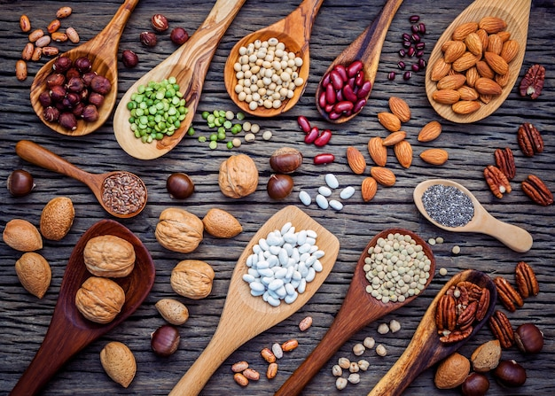 Selection food sources of omega 3 and unsaturated fats on wooden background.