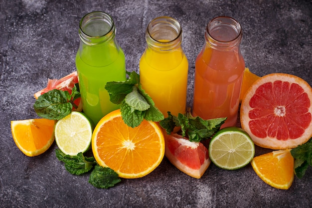 Selection of fresh citrus juices. detox drinks. selective focus