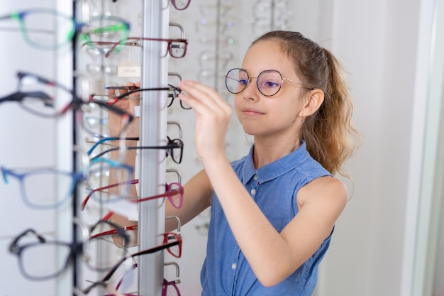 Selection of glasses in the shop of glasses for vision correction
