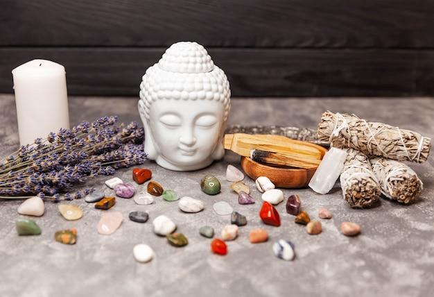 Selection of semiprecious stones ceramic statuette of a buddha head