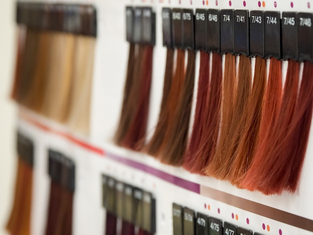 Selection of a shade of hair dye. color of hair dyes.