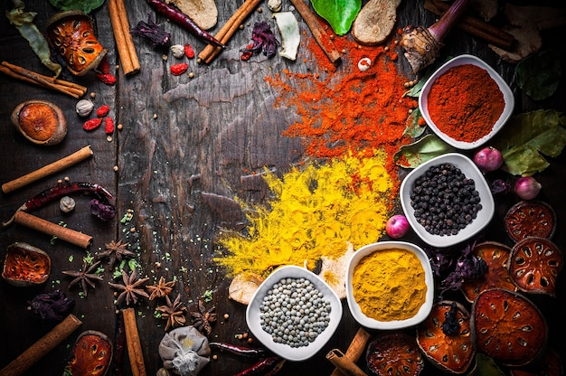 Selection of spices herbs and ingredients for cooking, food background on wooden table