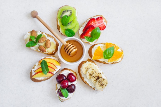 Selection summer sweet snacks. bruschetta or sandwiches