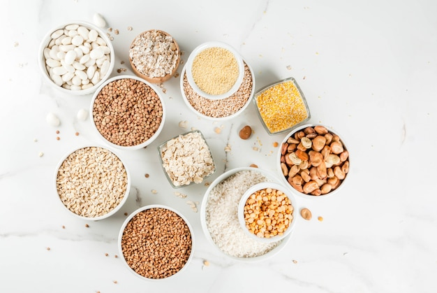 Selection various types cereal grains groats  in different bowl