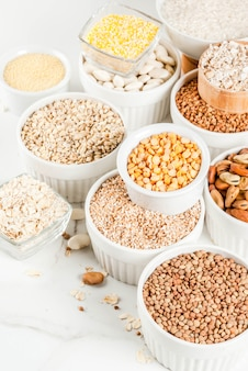 Selection various types cereal grains groats  in different bowls